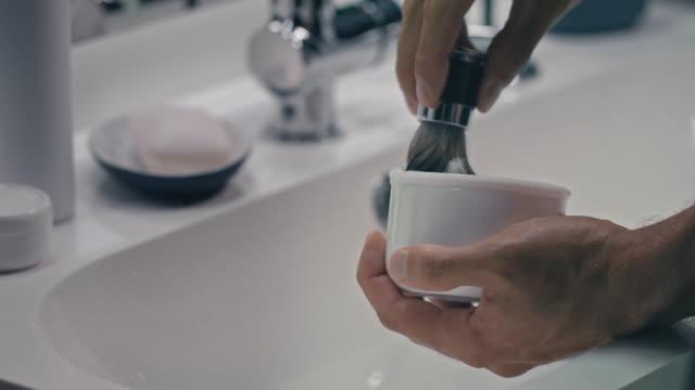 Man using shaving brush
