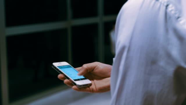 Man using smart phone at subway station