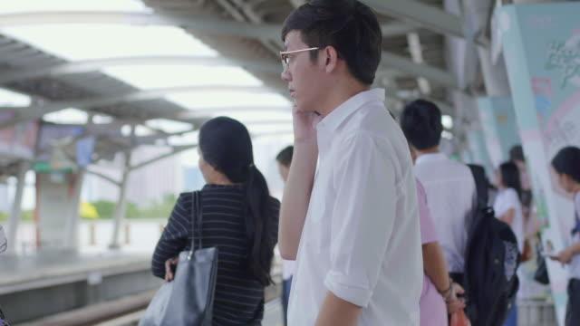 Man using smart phone on the subway station