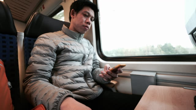 Man using smart phone on the train