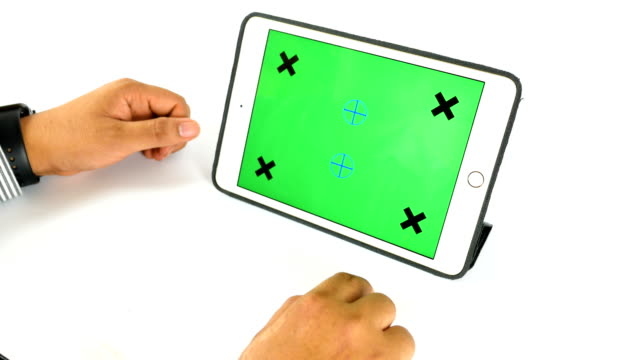 Man using smart watch and tablet with green screen on white background, chroma key