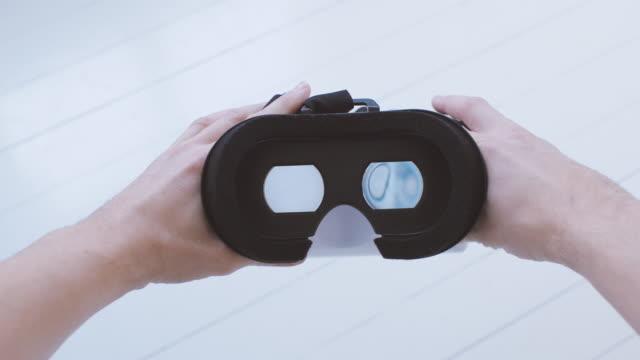 Man using Virtual Reality Glasses POV
