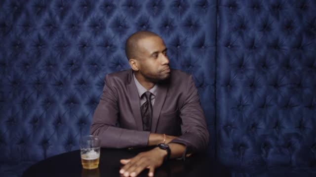 Man Waiting in Bar