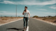 Man walking along road