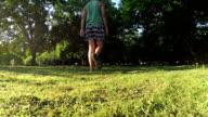 Man walking on a green park