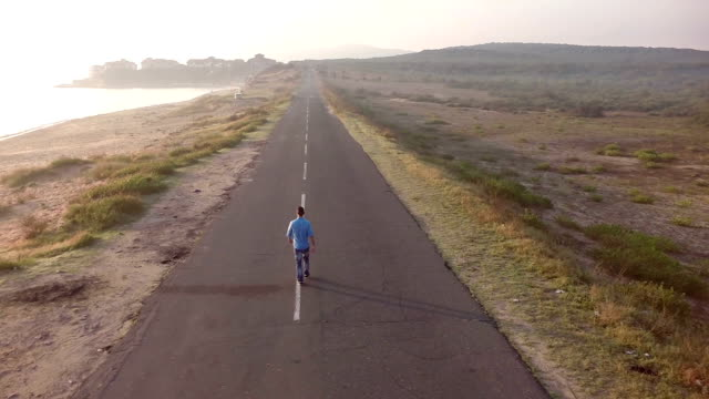 Man walking on street aerial view