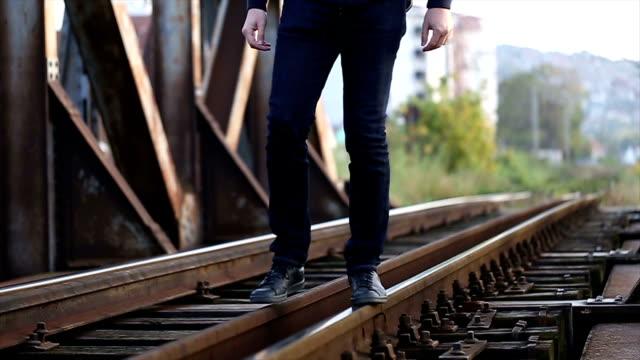 Man walking on tracks