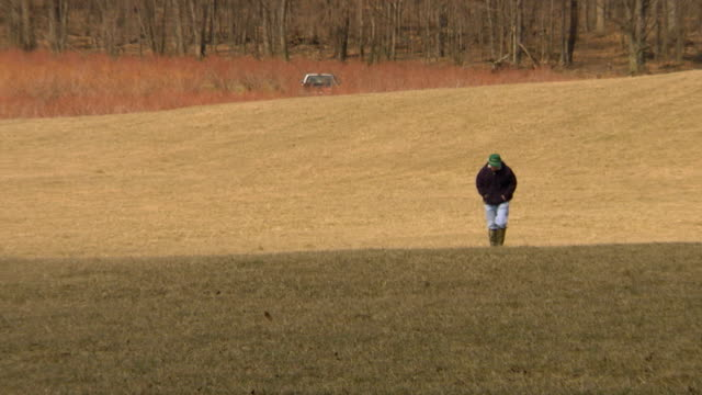 Man walking then running across an open field
