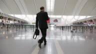 MS Man walking through airport terminal