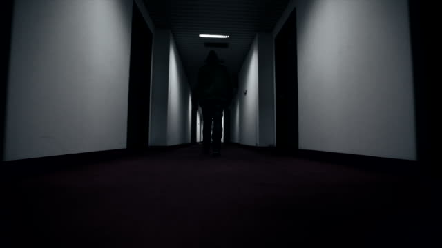 Man walking through hotel corridor