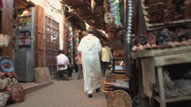 WS POV Man walking through souk, Marrakech, Morocco