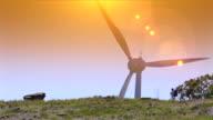 Man walks by a wind turbine