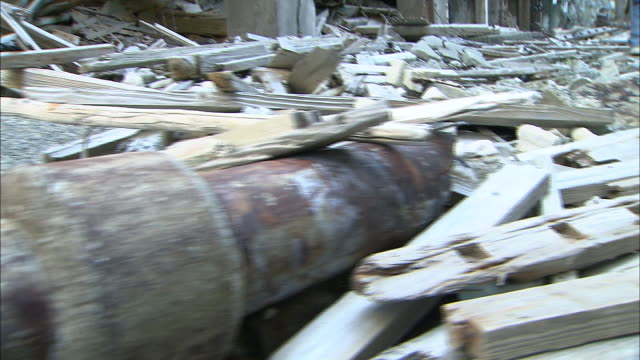 A man walks through the debris covering an abandoned city in Nagasaki, Japan.