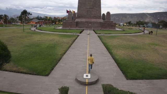 Man walks towards Monument to the Equator