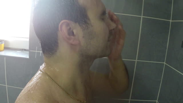 Man washes his hair
