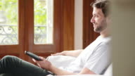 Man watching sports match on tv at home