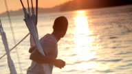 Man Watching the Sunset from a Yacht