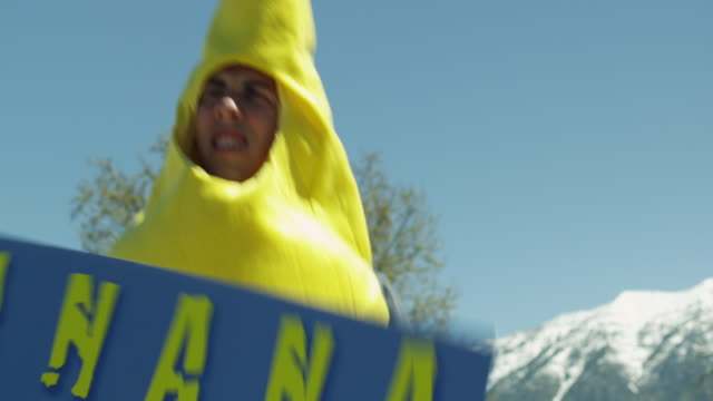 CU Man wearing banana costume holding advertisement / Orem, Utah, USA