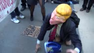 Man wearing Trump mask gets spanked / AntiDonald Trump protest outside of the Grand Hyatt Hotel and Grand Central Station / 42nd Street Midtown...