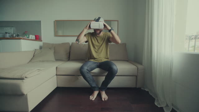Man wearing virtual reality headset slowmotion