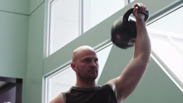MS Man weightlifting in gym / Draper, Utah, USA
