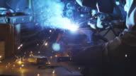 SLO MO MCU DOLLY man welding in home garage