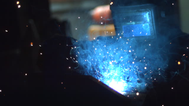 CU SLO MO Man welding / Manchester, United Kingdom