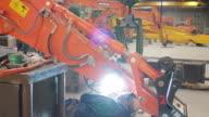 Man welding on a digger