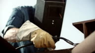 Man welding outside