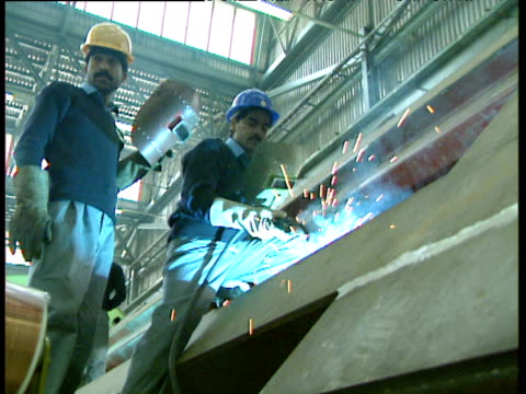 Man welds in Pakistan Locomotive Factory Risalpur Pakistan