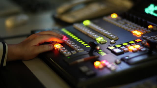 A man who control a TV Broadcasting control room