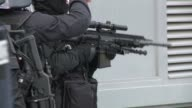 A man who holed up in a post office in a suburb northwest of Paris with two hostages on Friday surrendered and has been arrested