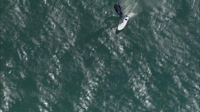 AERIAL WS Man wind surfing on River Drac / Rhone-Alpes, France