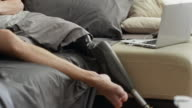 Man with artificial leg watching TV and relaxing at home