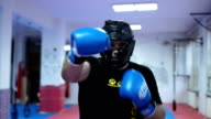 Man with boxing equipment