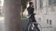 Man With Bun Commuting With Bicycle.