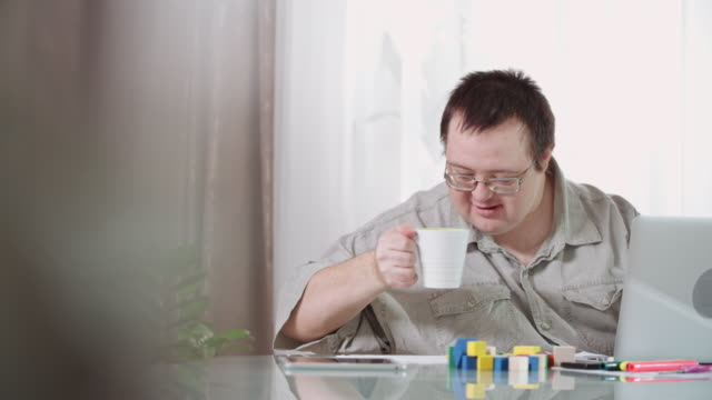 Man with cognitive disability working on laptop