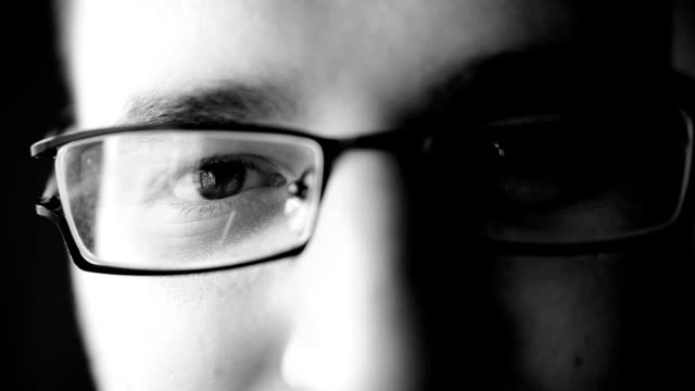 Man with eyeglasses. Close up. Black and white.