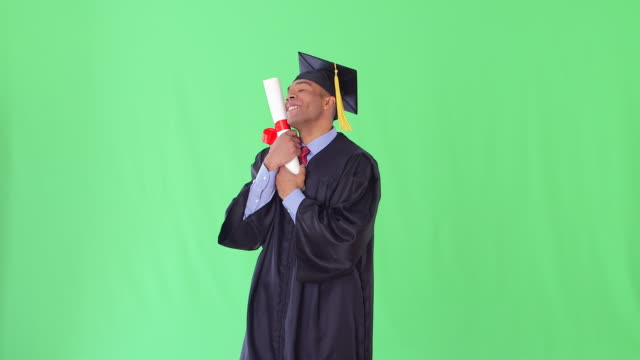 man with graduation gown and diploma
