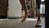 Man with prosthetic leg and his dog walking at home