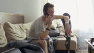 Man with prosthetic leg relaxing and chatting on mobile phone