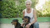 MS Man with rottweilers / Havana, Cuba