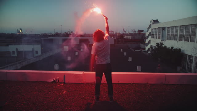 Man with torch on rooftop