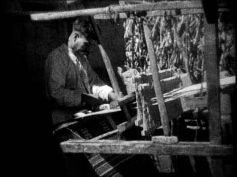 1930 MONTAGE Man working at an industrial loom / Mexico City, Mexico
