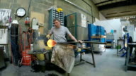 Man working on glass object