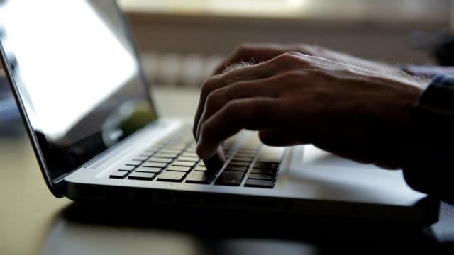 Man working on laptop, computer