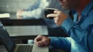 CU TU Man working on laptop in busy coffee shop / Seattle, Washington, USA