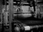 A man works at a weaving loom at the Royal College of Arts