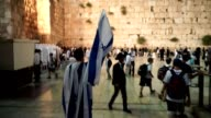 A man wrapped in the Israeli flag makes his way to the Western Wall for the 50th Celebration