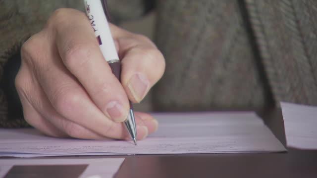 Man writing close up, USA